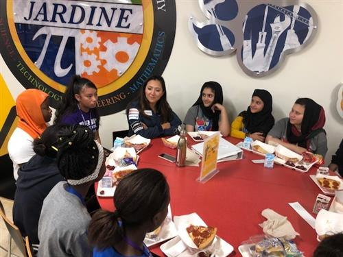 Shaesta having lunch with some students
