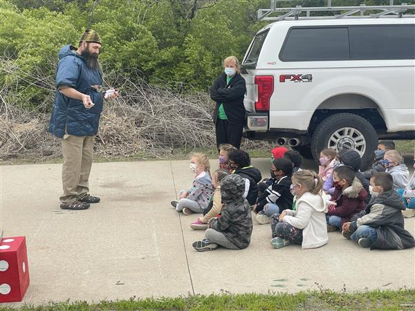 Earhart Elementary students listen to a presentation on Earth Day