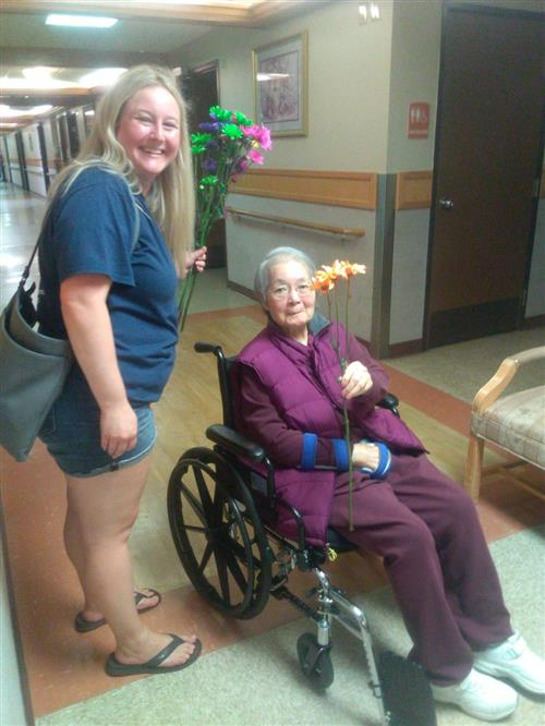 Cleaveland gives flowers to nursing home residents