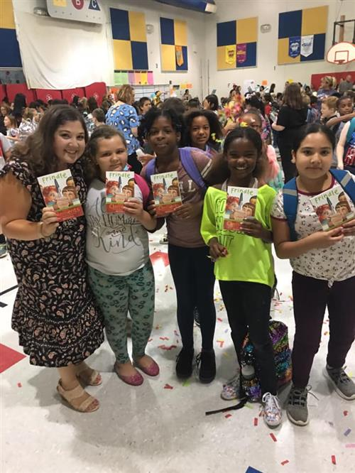 Enterprise students receive new books
