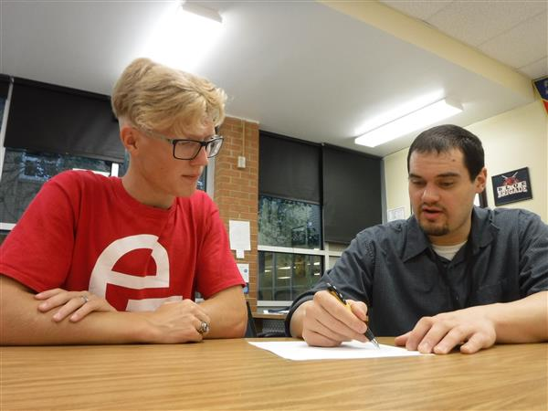 Heights High School CCC coordinator David Ghitis works with a student