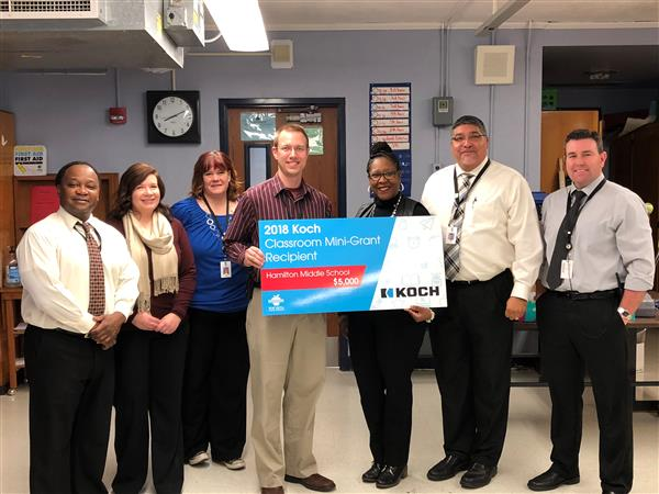 Hamilton science teacher Brian Campbell receives Koch mini-grant.