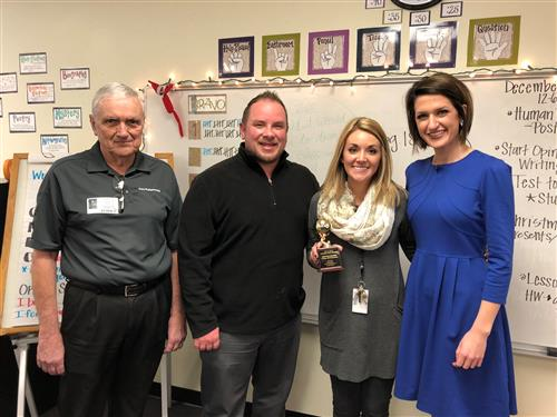 Kristine Hayden receives Golden Apple Award.