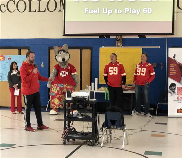Kansas City Chiefs players and KC Wolf at McCollom Elementary