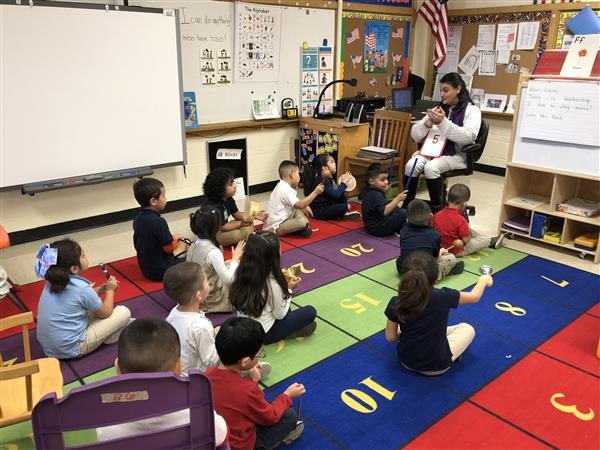 Vinnie Reed uses musical instruments to connect with students