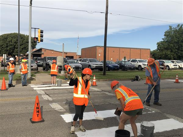 The school crosswalk at Caldwell Elementary was repainted by volunteers