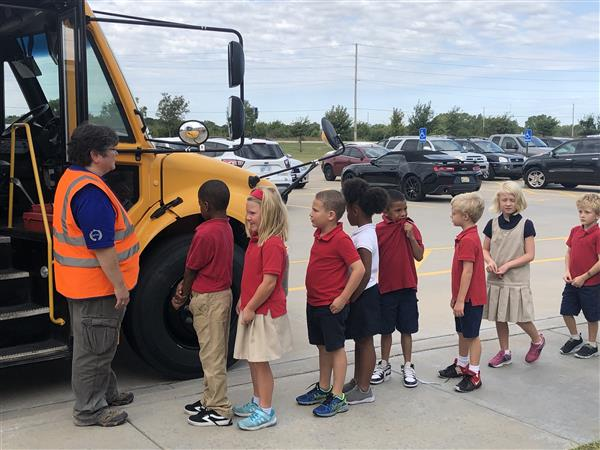 Isely Elementary students learn about bus safety from First Student.