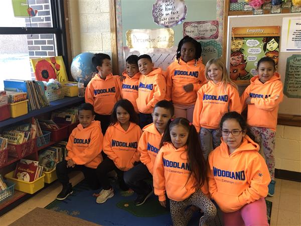 Woodland Health & Wellness Magnet students wearing new hoodies from Kansas Health Foundation