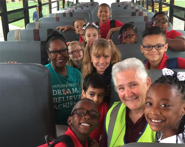 Supt. Alicia Thompson on the bus with students from Minneha