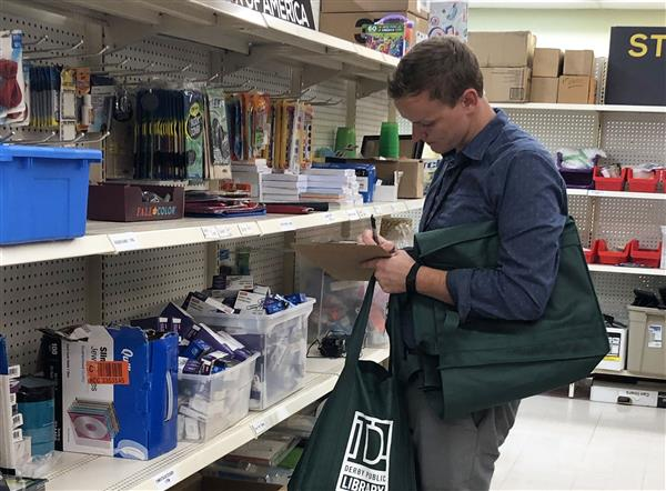 Coleman Middle School social studies teacher Sam Belsan shopping for school supplies