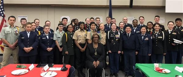 Superintendent Dr. Alicia Thompson poses with JROTC and leadership cadets