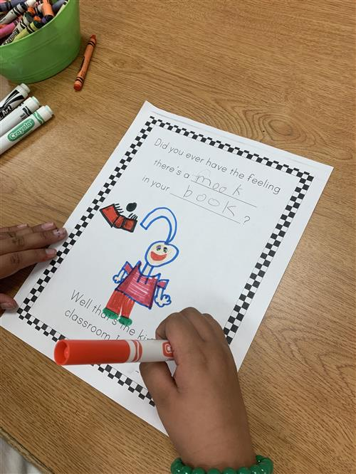 1st graders using their creative writing skills modeling Dr. Seuss
