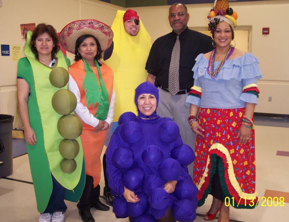 Start of Eat, Exercise, Excel at Woodland. McGhee with volunteers in costumes.