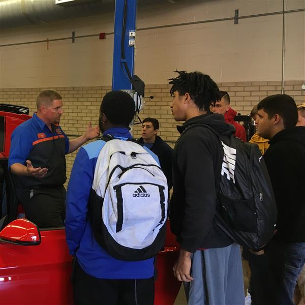 Volunteer from Mel Hambleton Ford talks with automotive students at South High
