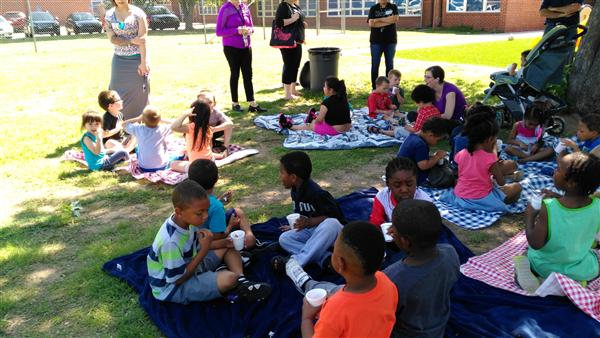 Students enjoy a healthy picnic snack